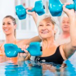 stock-photo-80329795-people-at-water-gymnastics-in-physiotherapy[1]